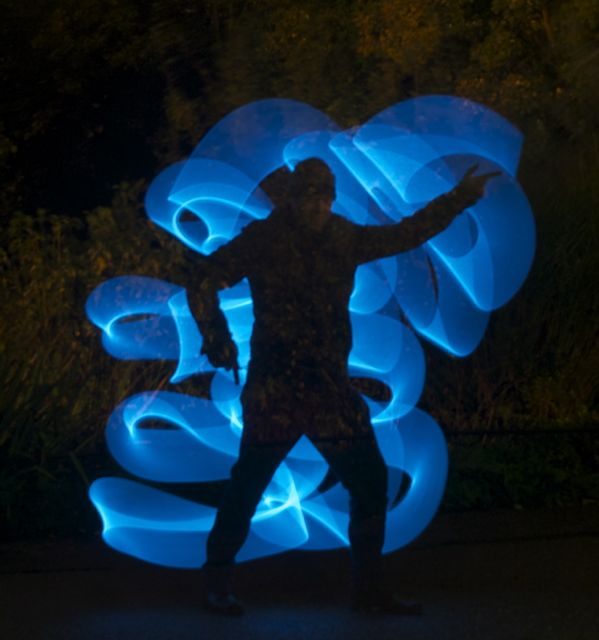 blue swirly light thing with person